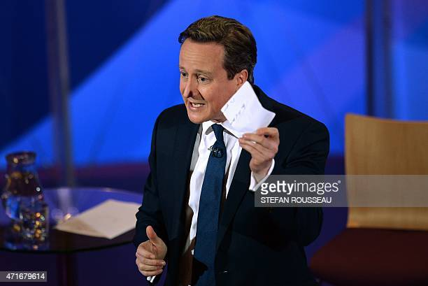 British Prime Minister and leader of the Conservative Party David Cameron takes part in the BBC Question Time Election Leaders Special television...