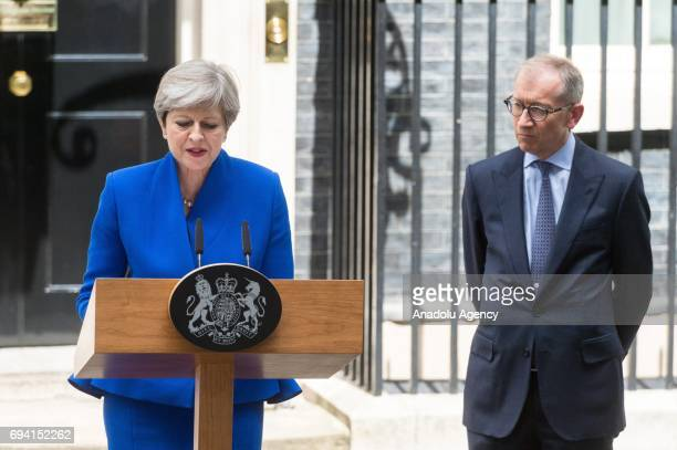British Prime Minister and leader of the Conservative Party Theresa May delivers a speech to members of the media, as her husband Philip May ,...