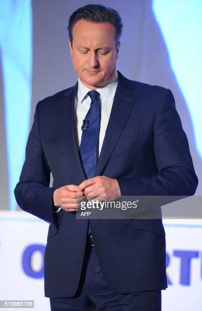 TOPSHOT British Prime Minister and leader of the Conservatives David Cameron addresses delegates during the Conservative party Spring Forum in...