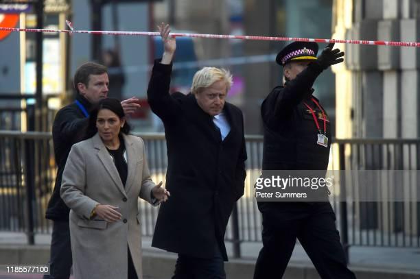 British Prime Minister Boris Johnson accompanied by Britain's Home Secretary Priti Patel visits the scene of yesterday's London Bridge stabbing...