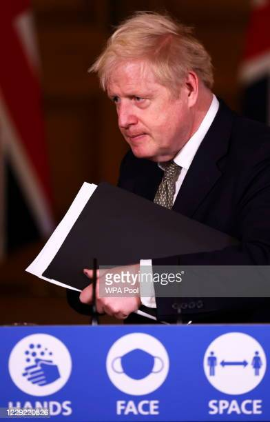 British Prime Minister Boris Johnson addresses the nation during a news conference on the coronavirus at 10 Downing Street on October 22 2020 in...