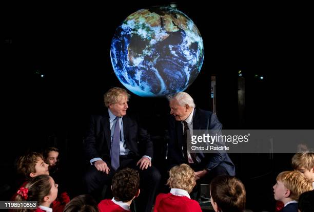 British Prime Minister Boris Johnson and British broadcaster and naturalist Sir David Attenborough speak with school children during the launch of...