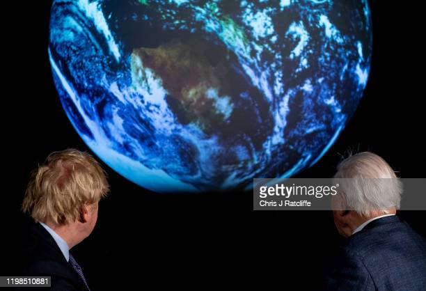 British Prime Minister Boris Johnson and British broadcaster and naturalist Sir David Attenborough look at a projection of planet earth during the...