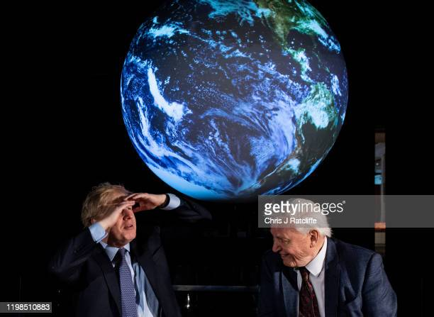 British Prime Minister Boris Johnson and British broadcaster and naturalist Sir David Attenborough attend the launch of the UKhosted COP26 UN Climate...