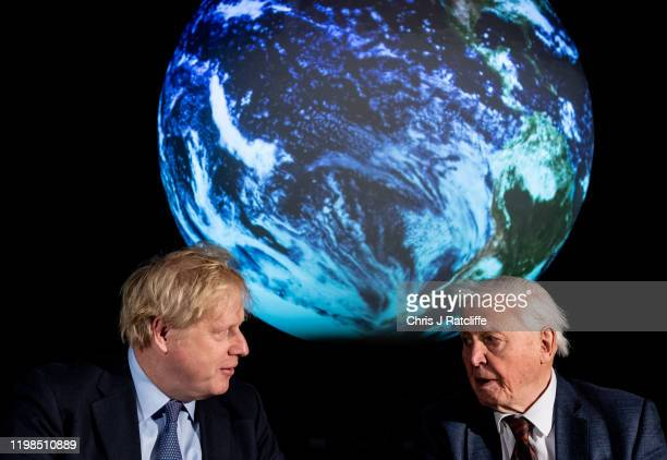 British Prime Minister Boris Johnson and British broadcaster and naturalist Sir David Attenborough speak during the launch of the UKhosted COP26 UN...