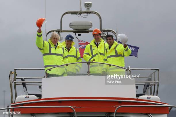 British Prime Minister Boris Johnson and Chancellor of the Exchequer Rishi Sunak , stand on board a boat with 2nd left blue hat, Jerry Hopkinson...