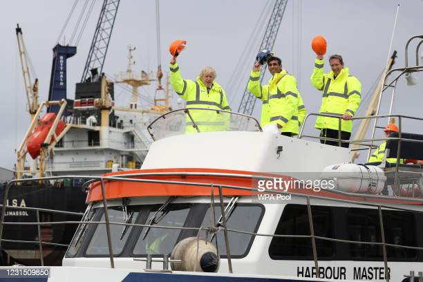 British Prime Minister Boris Johnson and Chancellor of the Exchequer Rishi Sunak , stand on board a boat with with Frans Calje, Chief Executive...