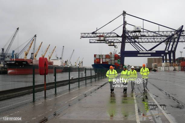 British Prime Minister Boris Johnson and Chancellor of the Exchequer Rishi Sunak , walk during a visit to Teesport on March 4, 2021 in Teesport,...