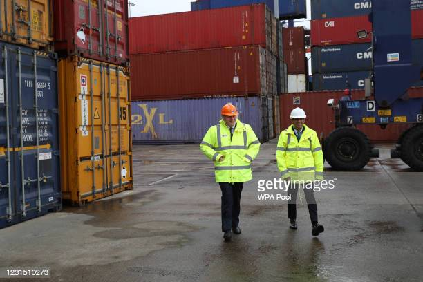 British Prime Minister Boris Johnson and Chancellor of the Exchequer Rishi Sunak , walk past shipping containers on March 4, 2021 in Teesport,...