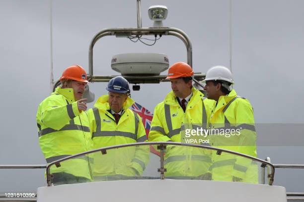 British Prime Minister Boris Johnson and Chancellor of the Exchequer Rishi Sunak , stand on board a boat on the River Tees on March 4, 2021 in...