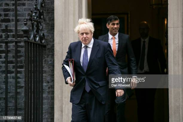 British Prime Minister Boris Johnson and Chancellor Rishi Sunak head to the weekly cabinet meeting held at the British Foreign and Commonwealth...