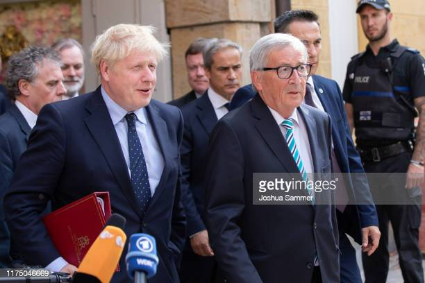 British Prime Minister Boris Johnson and European Commission President JeanClaude Juncker emerge after having a working lunch together in a...