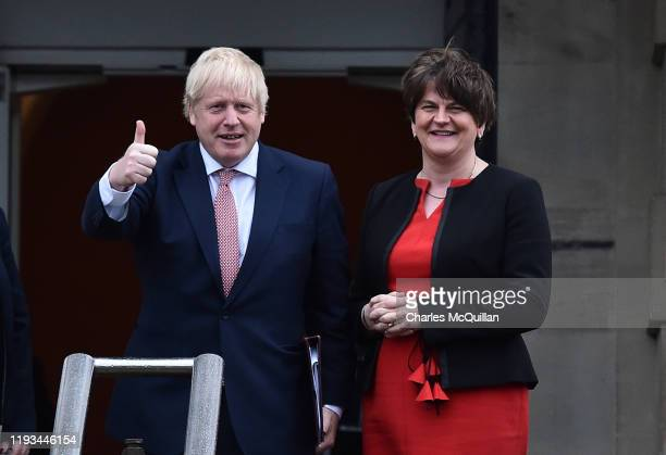 British Prime Minister, Boris Johnson and First Minister, Arlene Foster of the DUP pose for the cameras following meetings at Stormont on January 13,...