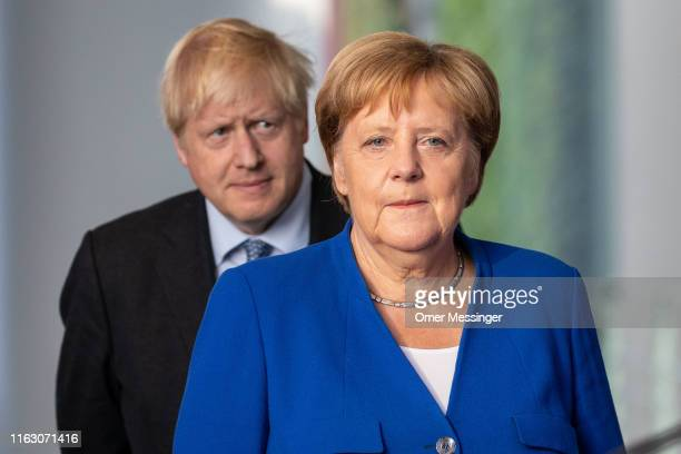British Prime Minister Boris Johnson and German Chancellor Angela Merkel attend a joint press conference following Johnson's arrival at the...
