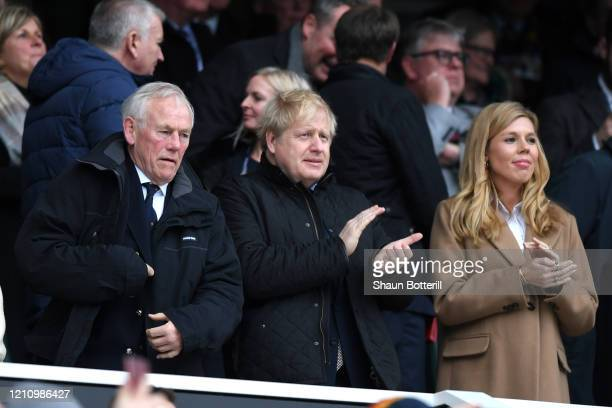 British Prime Minister Boris Johnson and his partner Carrie Symonds are seen in the stands during the 2020 Guinness Six Nations match between England...