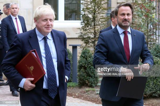 British Prime Minister Boris Johnson and Luxembourg's Prime Minister Xavier Bettel leave a meeting with EU Commission President and officials in...