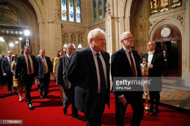 British Prime Minister Boris Johnson and main opposition Labour Party leader Jeremy Corbyn head the procession of members of parliament through the...