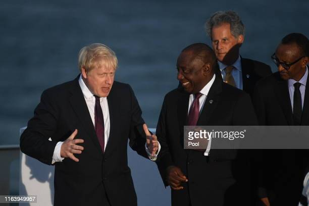 British Prime Minister Boris Johnson and South Africa's President Cyril Ramaphosa join G7 leaders and guests as they gather for a family picture in...