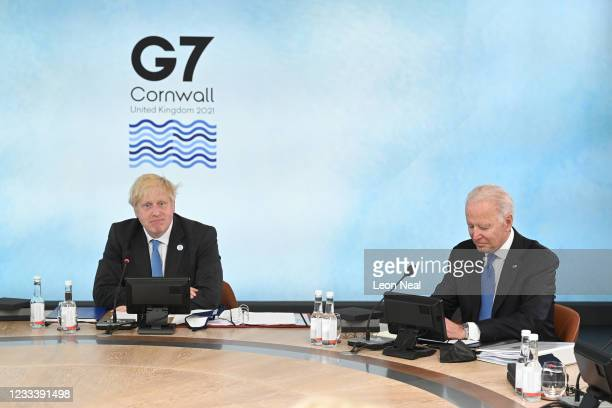 British Prime Minister Boris Johnson and US President Joe Biden sit around the table at the top of the G7 meeting in Carbis Bay, on June 11, 2021 in...