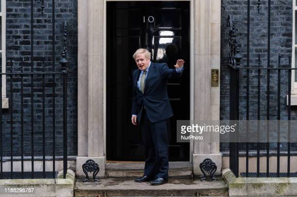 British Prime Minister Boris Johnson arrives in Downing Street from Buckingham Palace after obtaining Queen's permission to form a new government on...