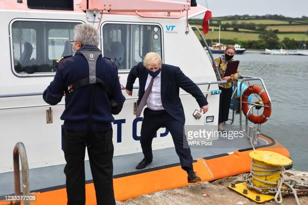 British Prime Minister Boris Johnson arrives to visit the workshop of Scott Woyka, who built some of the furniture for the G7 Summit, ahead of the G7...