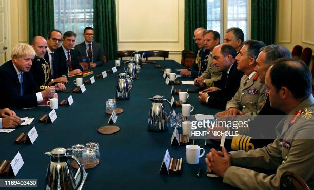 British Prime Minister Boris Johnson attends a roundtable meeting with military chiefs at Downing Street in London on September 19 2019