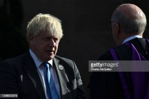 """British Prime Minister, Boris Johnson chats with the clergy following a service of """"Reflection & Hope"""" to mark the centenary of Northern Ireland at..."""