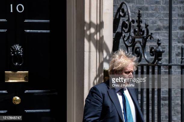 British Prime Minister, Boris Johnson, departs 10 Downing Street for Prime Ministers Questions at the Houses of Parliament on May 13, 2020 in London,...