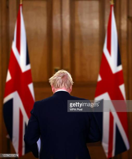 British Prime Minister Boris Johnson departs after addressing the nation during a news conference on the coronavirus at 10 Downing Street on October...