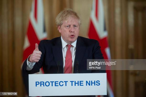 British Prime Minister Boris Johnson gestures as he speaks during a daily press conference at 10 Downing Street on March 20 2020 in London England...