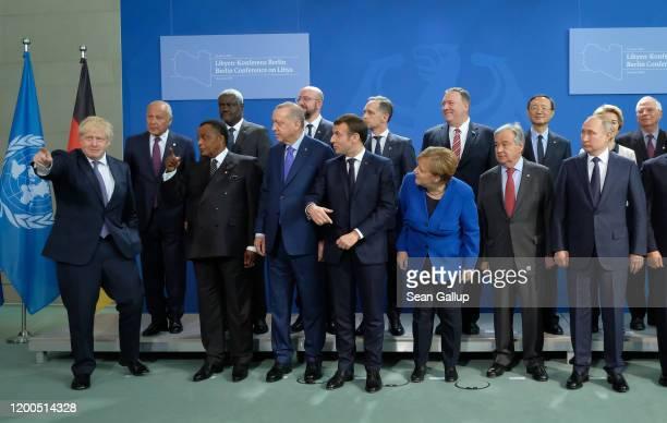 British Prime Minister Boris Johnson gestures as other participants including German Chancellor Angela Merkel French President Emmanuel Macron...