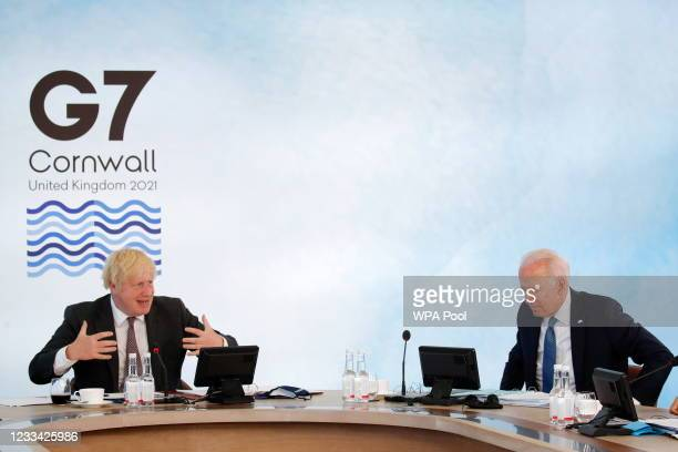 British Prime Minister Boris Johnson gestures as U.S. President Joe Biden sits in a plenary session during G7 summit in Carbis Bay on June 13, 2021...