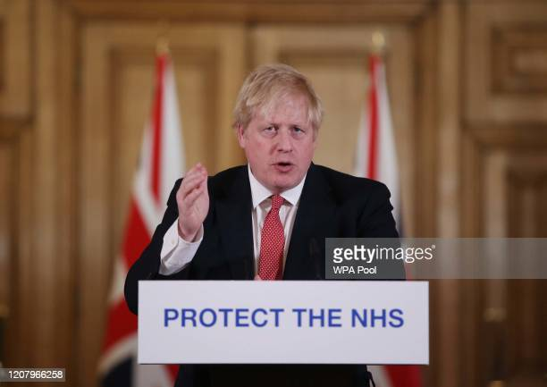 British Prime Minister Boris Johnson gives his daily COVID 19 press briefing at Downing Street on March 22 2020 in London England Coronavirus...