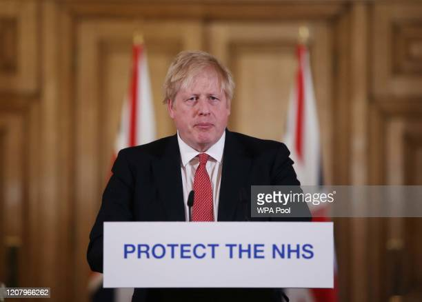 British Prime Minister Boris Johnson gives his daily COVID 19 press briefing at Downing Street on March 22, 2020 in London, England. Coronavirus...