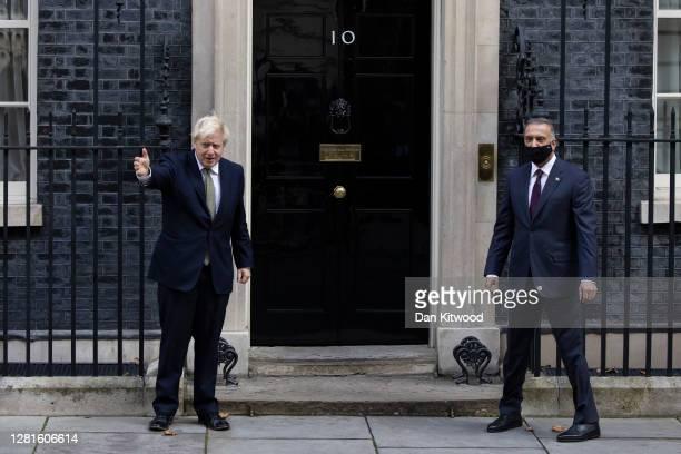 British Prime Minister Boris Johnson greets Iraqi Prime Minister Mustafa Al-Kadhimi on the steps of Downing Street on October 22, 2020 in London,...