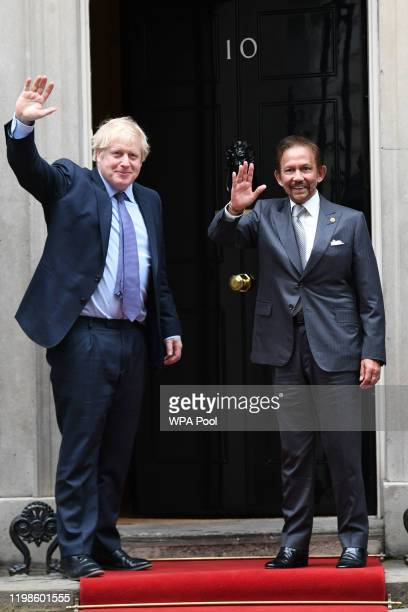 British Prime Minister Boris Johnson greets the Sultan of Brunei Hassanal Bolkiah during an official visit to Downing Street on February 04, 2020 in...