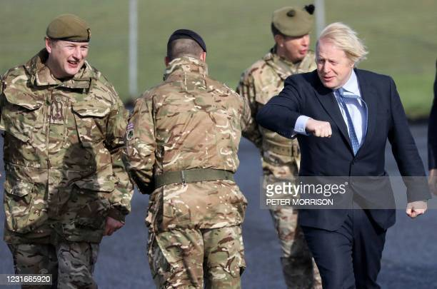 British Prime Minister Boris Johnson greets troops, as he is met by Brigadier Chris Davies , Commander 38 Brigade, during a visit to Joint Helicopter...