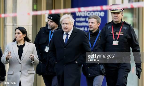 British Prime Minister Boris Johnson Home Secretary Priti Patel and City of London commissioner Ian Dyson visit the scene of yesterday's London...