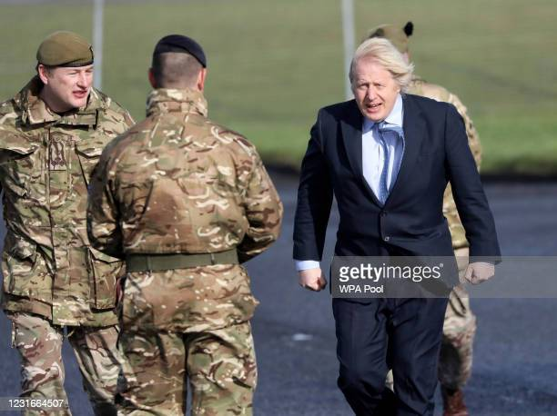 British Prime Minister Boris Johnson is greeted by Brigadier Chris Davies, Commander 38 Brigade during a visit to Joint Helicopter Command Flying...