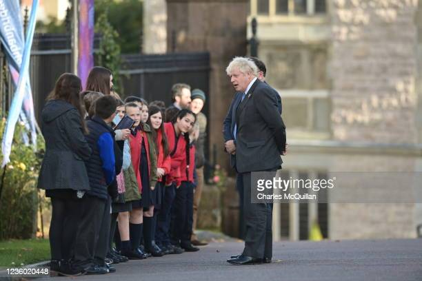 """British prime Minister, Boris Johnson is greeted by schoolchildren as he attends a service of """"Reflection & Hope"""" to mark the centenary of Northern..."""