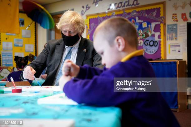 British Prime Minister Boris Johnson joins a reception class during their painting lesson during a visit to St Mary's CE Primary School on March 1,...
