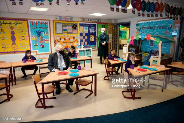 British Prime Minister Boris Johnson joins a Year 2 maths lesson during a visit to St Mary's CE Primary School on March 1, 2021 in Stoke-on-Trent,...