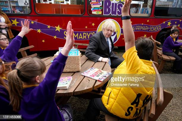 British Prime Minister Boris Johnson joins a Year 4 reading lesson outside during a visit to St Mary's CE Primary School on March 1, 2021 in...