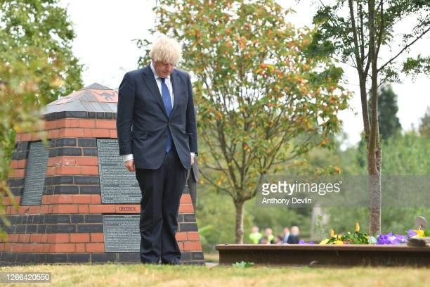British Prime Minister Boris Johnson lays a wreath during a national service of remembrance, marking the 75th anniversary of VJ Day, at the National...