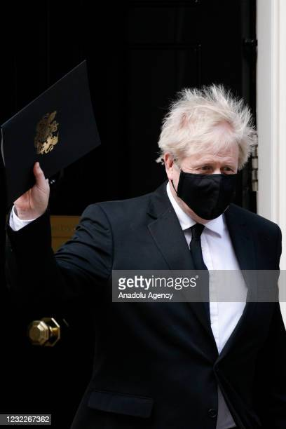 British Prime Minister Boris Johnson leaves 10 Downing Street for a session of Parliamentary tributes to Prince Philip in the House of Commons in...