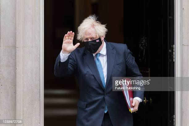 British Prime Minister Boris Johnson leaves 10 Downing Street for PMQs at the House of Commons on July 14, 2021 in London, England.