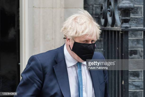 British Prime Minister Boris Johnson leaves 10 Downing Street for the House of Commons to give MPs an update on Covid-19 and lifting restrictions in...