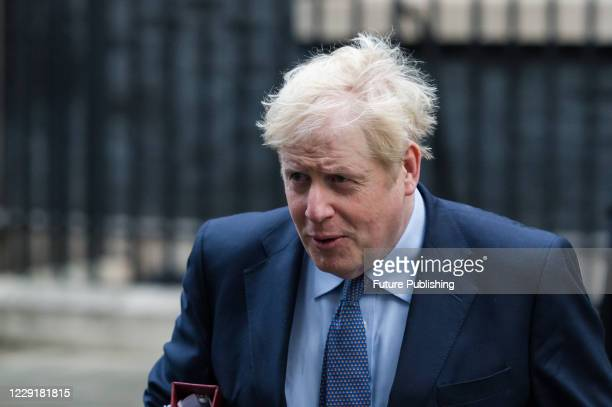 British Prime Minister Boris Johnson leaves 10 Downing Street in central London to attend Cabinet meeting at the Foreign Office on 20 October 2020 in...