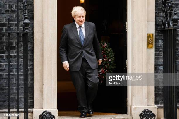 British Prime Minister Boris Johnson leaves 10 Downing Street to greet arriving Crown Prince Mohammed bin Zayed al-Nahyan of Abu Dhabi, in London,...