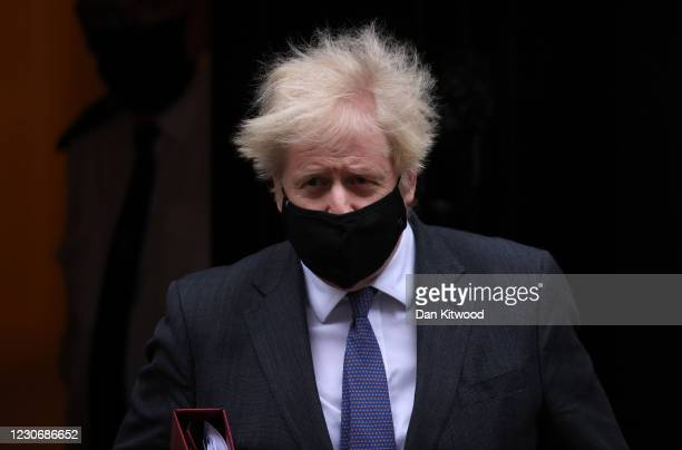 British Prime Minister Boris Johnson leaves 10 Downing Street to attend Prime Minister's Questions on January 20, 2021 in London, England. The...